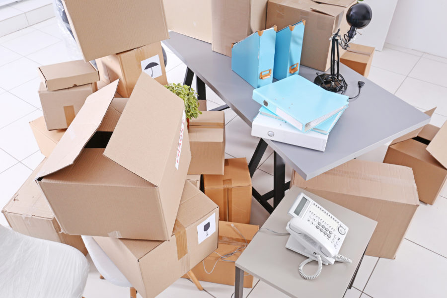 a pile of moving boxes
